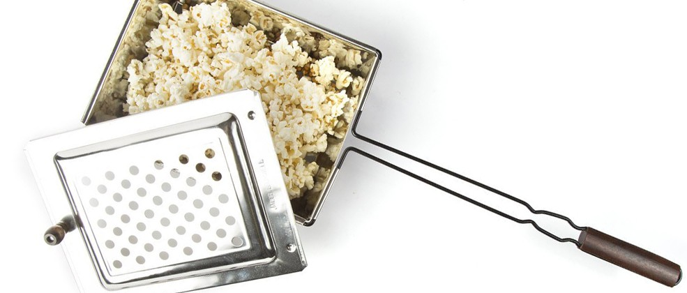 Ahh, the sweet smell of freshly popped popcorn over the open fire. With the kiddos crunching and laughing away, there's no better way to bring family and friends together than the good ol'fashioned way. Our Original Popcorn Popper is a customer favorite, especially with families. Kids love watching the kernels magically transform into fluffy popcorn, whether it's used over an open fire or kitchen stovetop.
